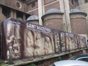 Telo che pubblicizza la mostra a ridosso del cantiere della Cattedrale